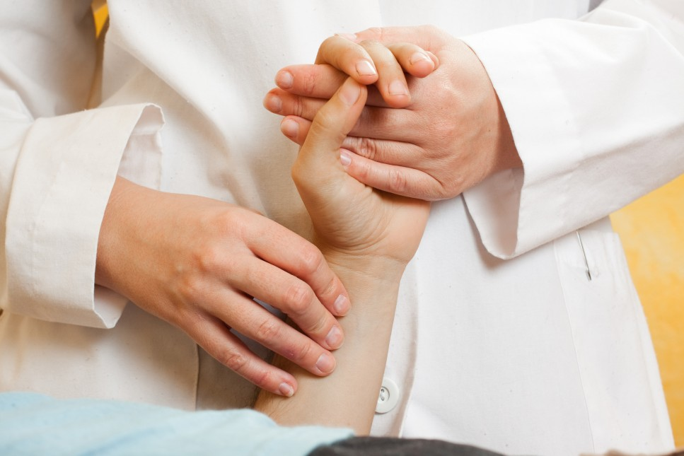bigstock-Chinese-doctor-checking-a-pati-6252016-e1393968958663