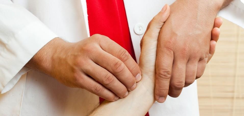 bigstock-Chinese-doctor-checking-a-pati-6252049-e1393975915577