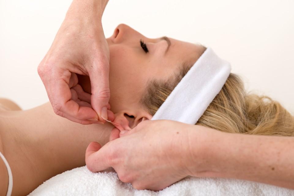 bigstock-Homeopath-Applying-An-Acupunct-58148315-e1393967889791